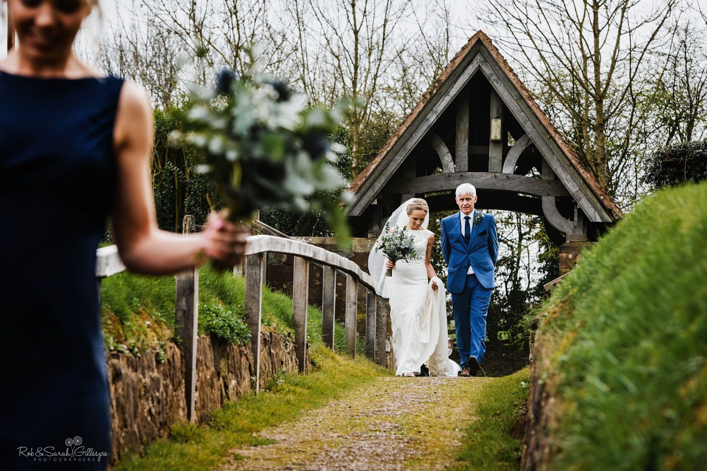 Bride and father walk St Kenelm's church in Worcestershire for wedding