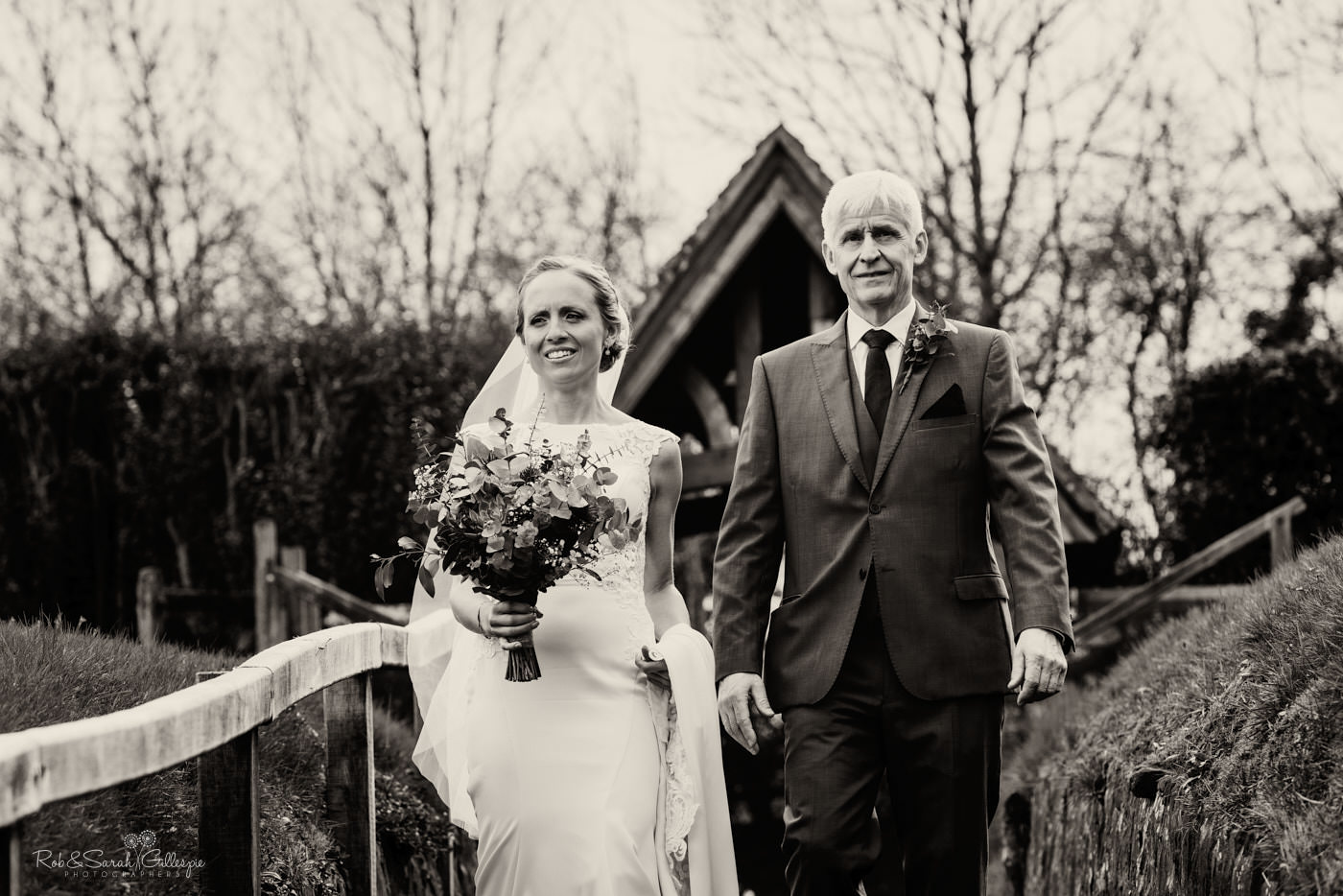 Bride and father walk to St Kenelm's in Romsley