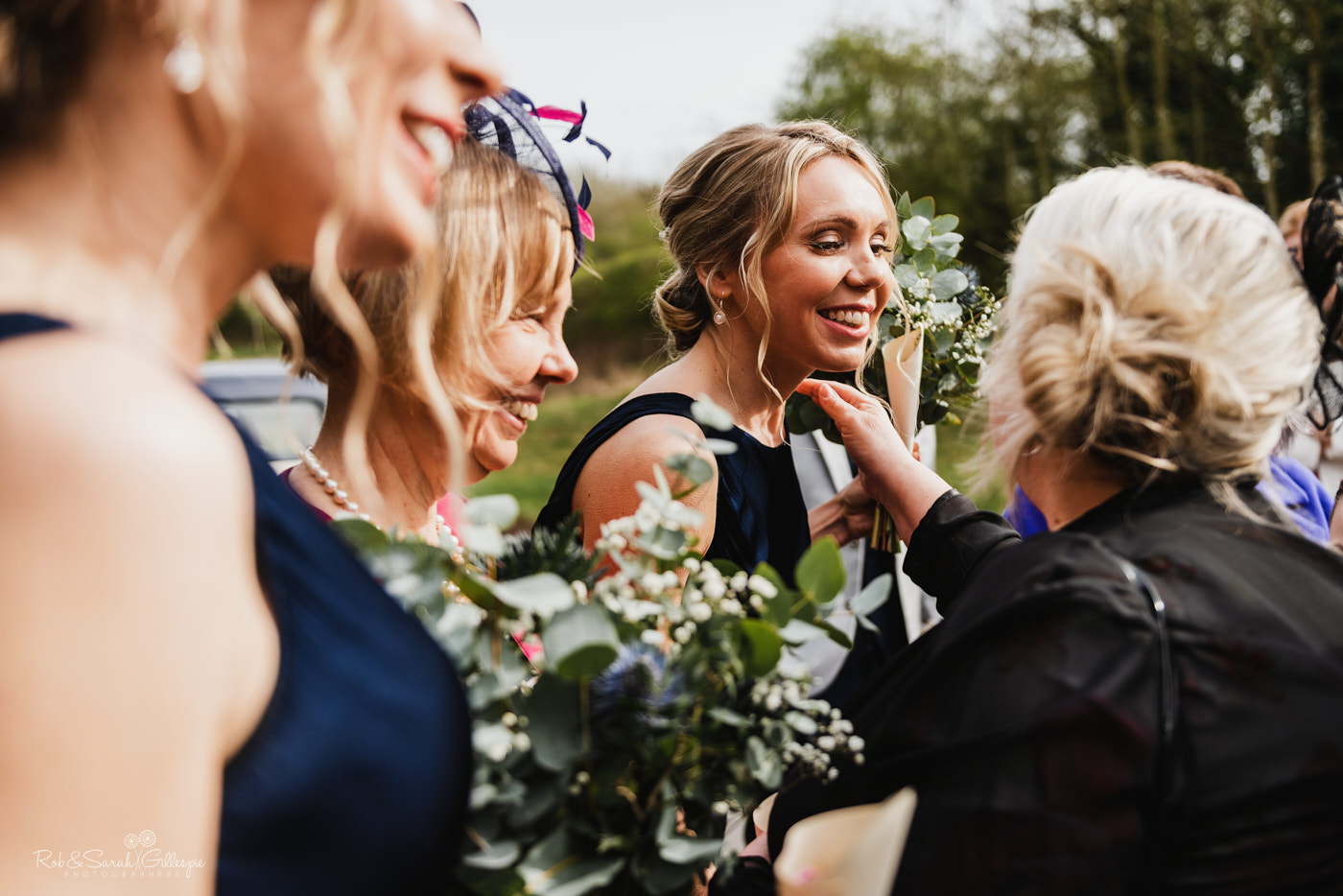 Wedding guests congratulate bride and groom at St Kenelm's church in Romsley