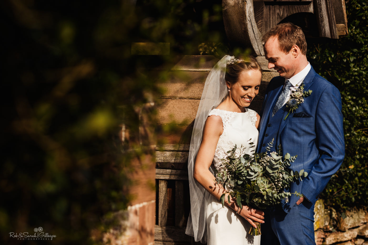 Bride and groom together at St Kenelm's church in Romsley