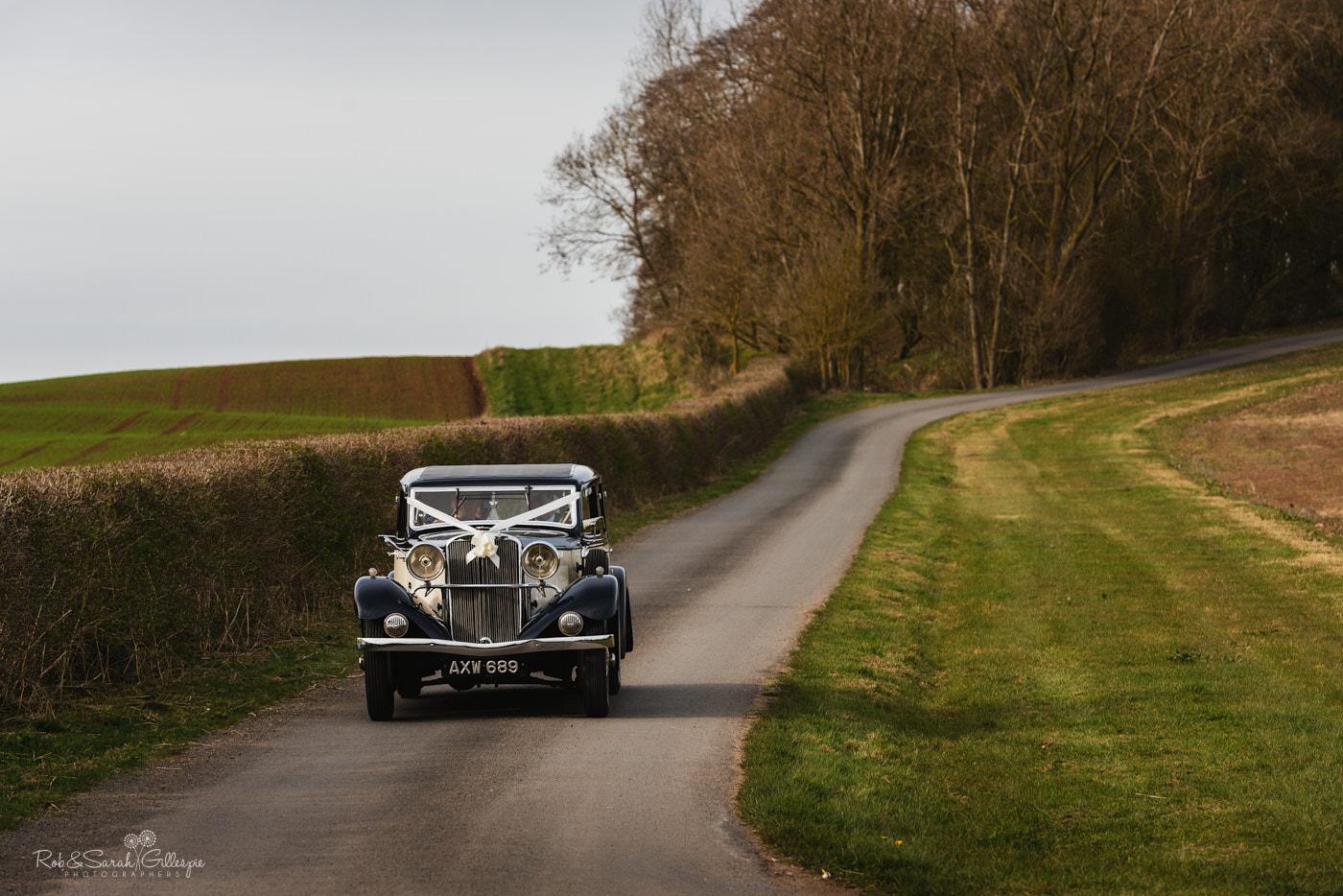 Wedding car arrives at Swallows Nest Barn