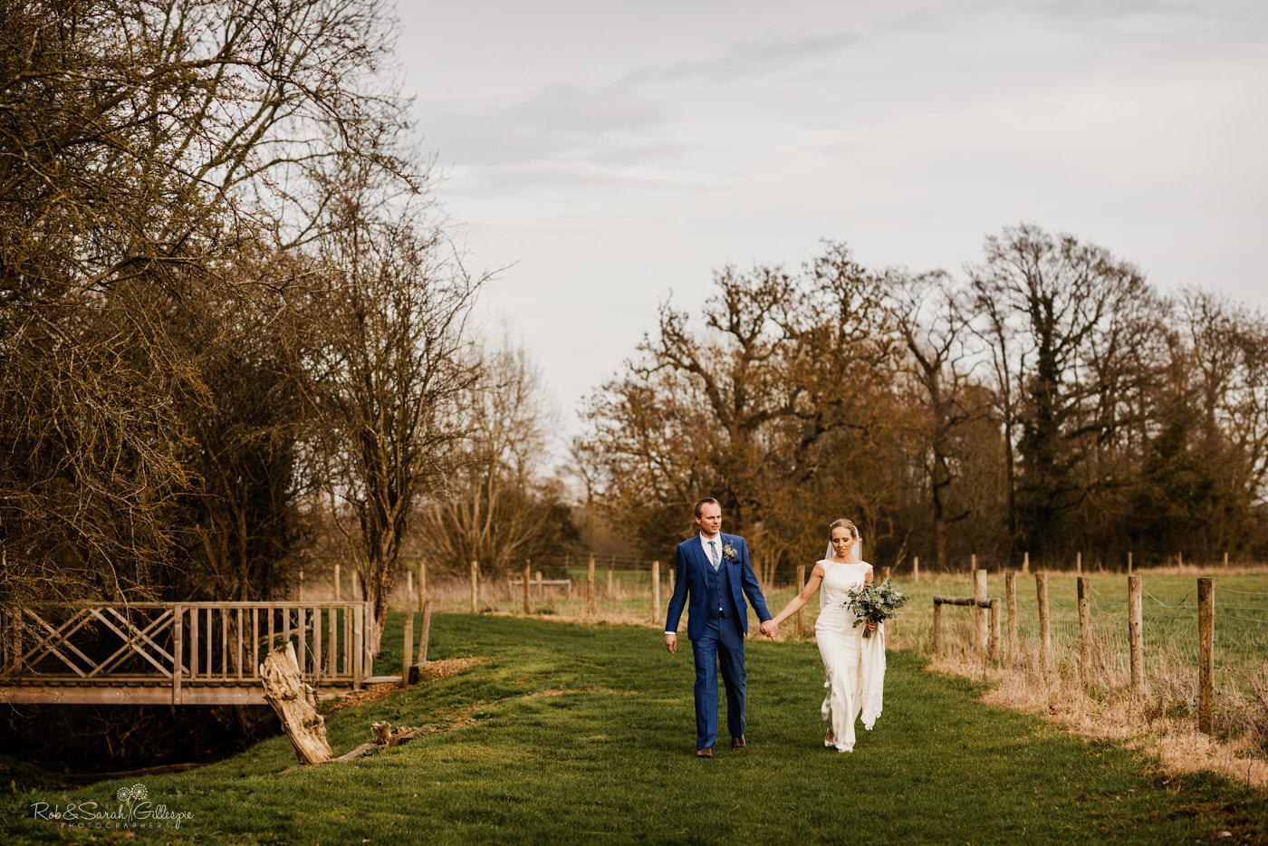 Bride and groom walking together at Swallows Nest Barn