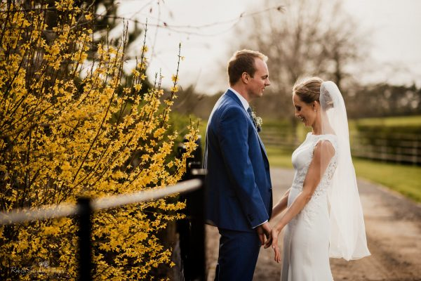 Bride and groom together in Swallows Nest Barn grounds