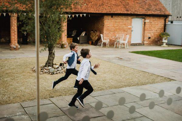 Children runing through courtyard at Swallows Nest Barn
