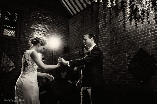 Wedding first dance at Swallows Nest Barn with beautiful light