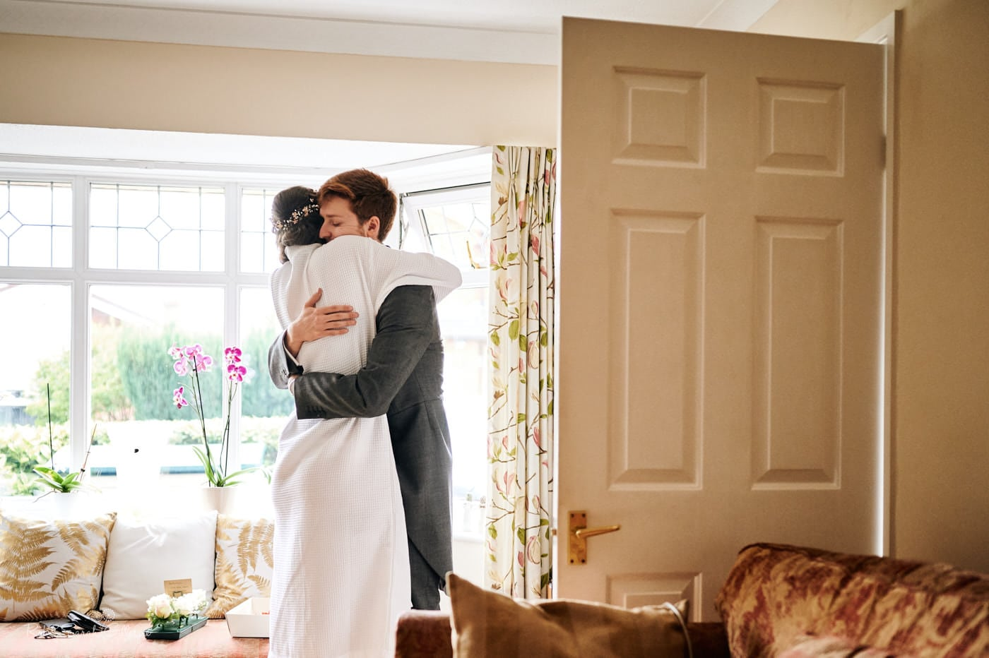 Bride hugs brother as she gets ready for wedding