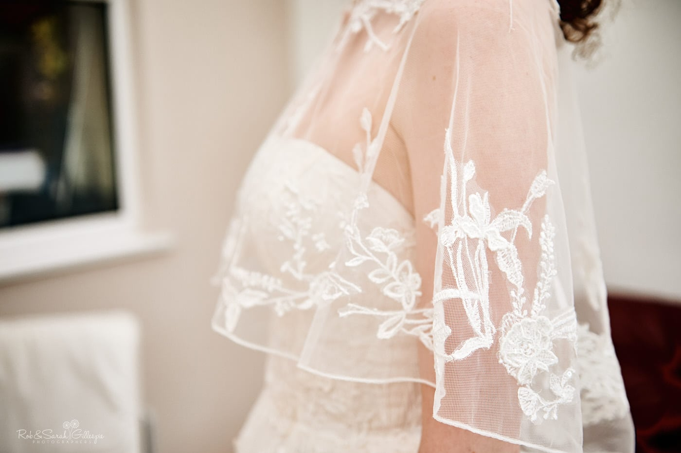 Detailf of bride's wedding dress