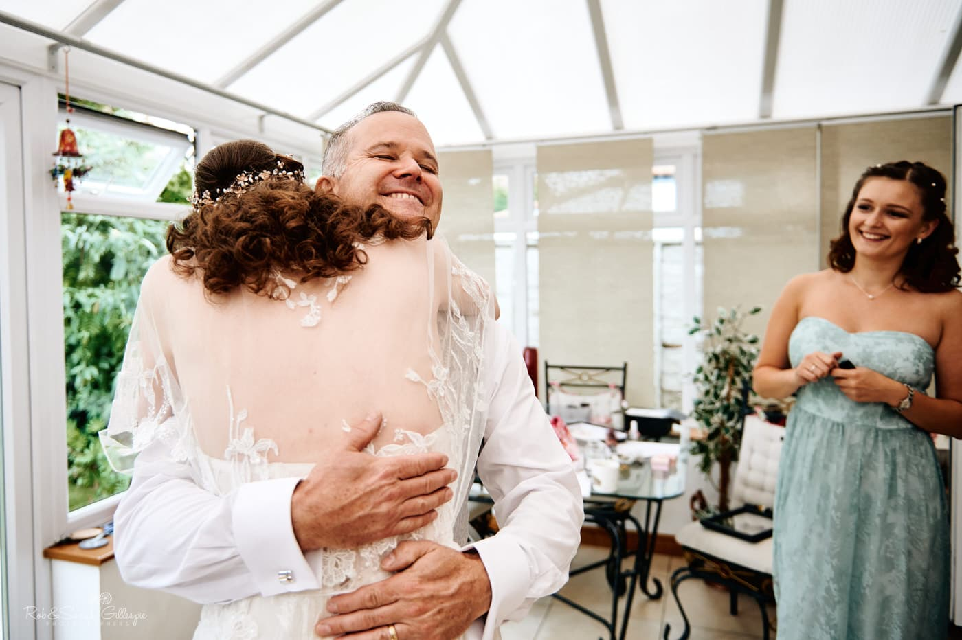 Bride' hugs dad when he sees her in wedding dress for the first time