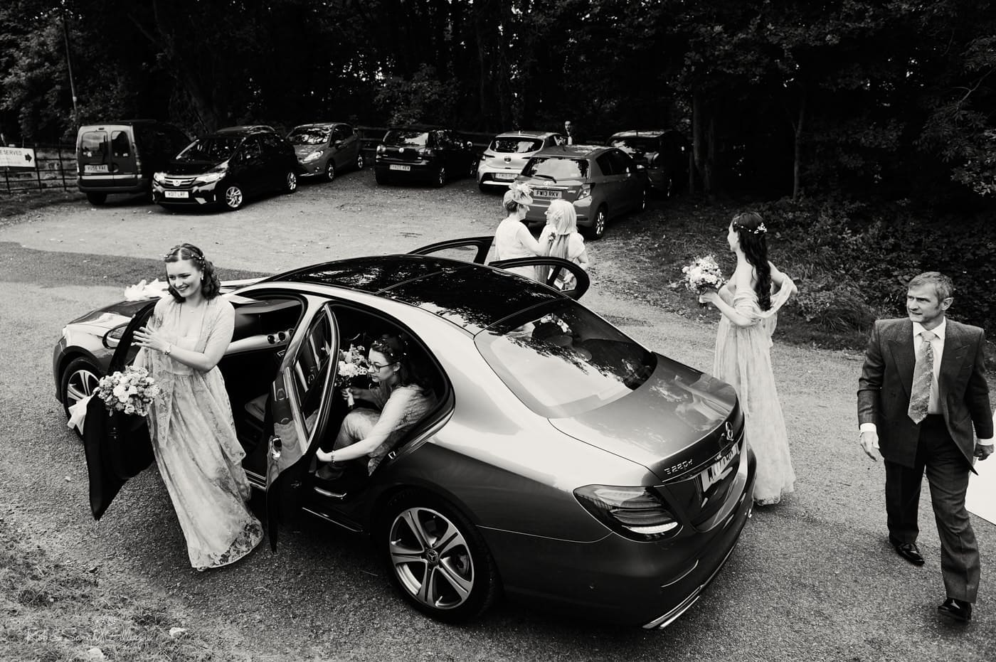 Bridesmaids arrive for wedding at Hanbury Church