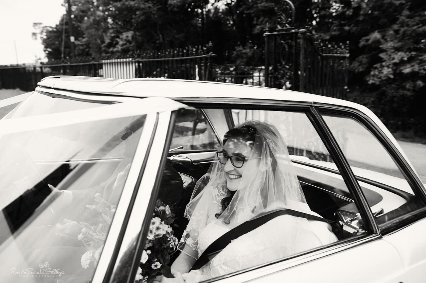 Bride arrives in car to Hanbury Church
