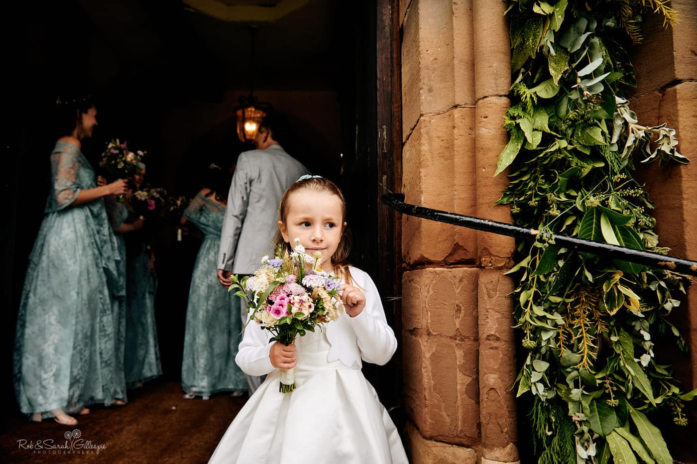 Flowergirl waiting for bride on steps at Hanbury Church