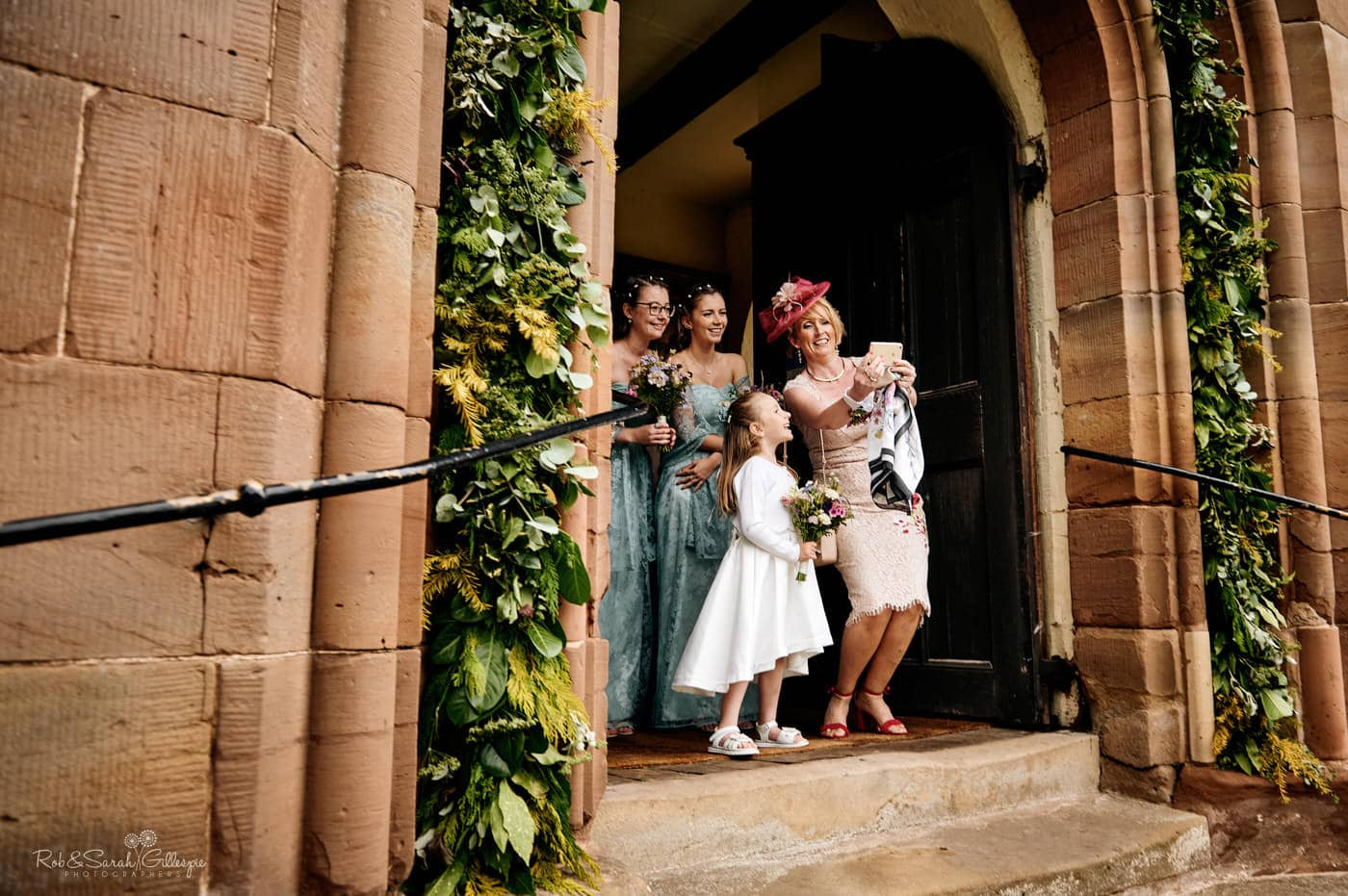 Bridesmaids waiting for bride at Hanbury Church