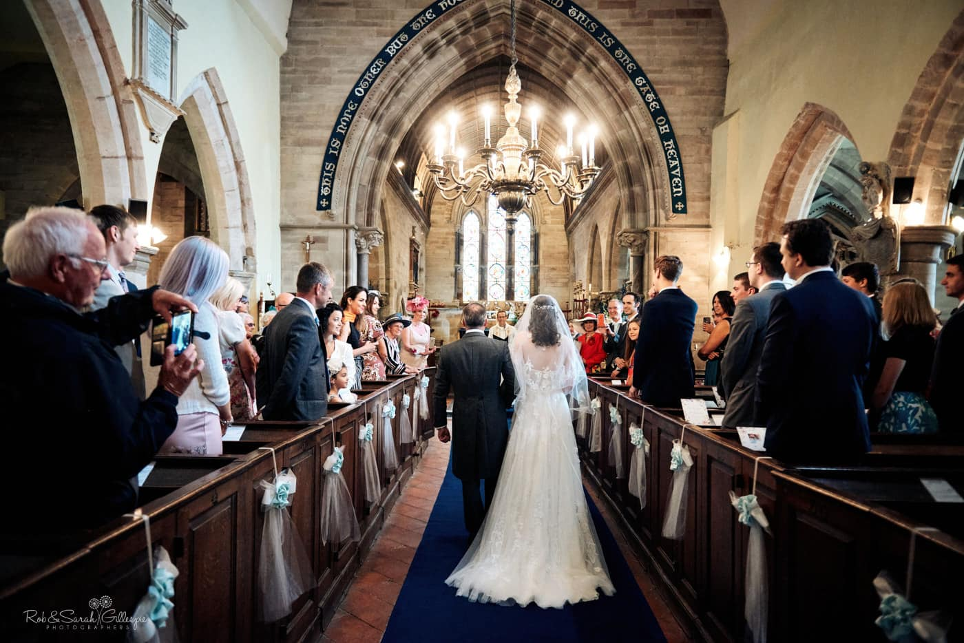 Bride and dad walk up aisle at Hanbury Church for wedding ceremony