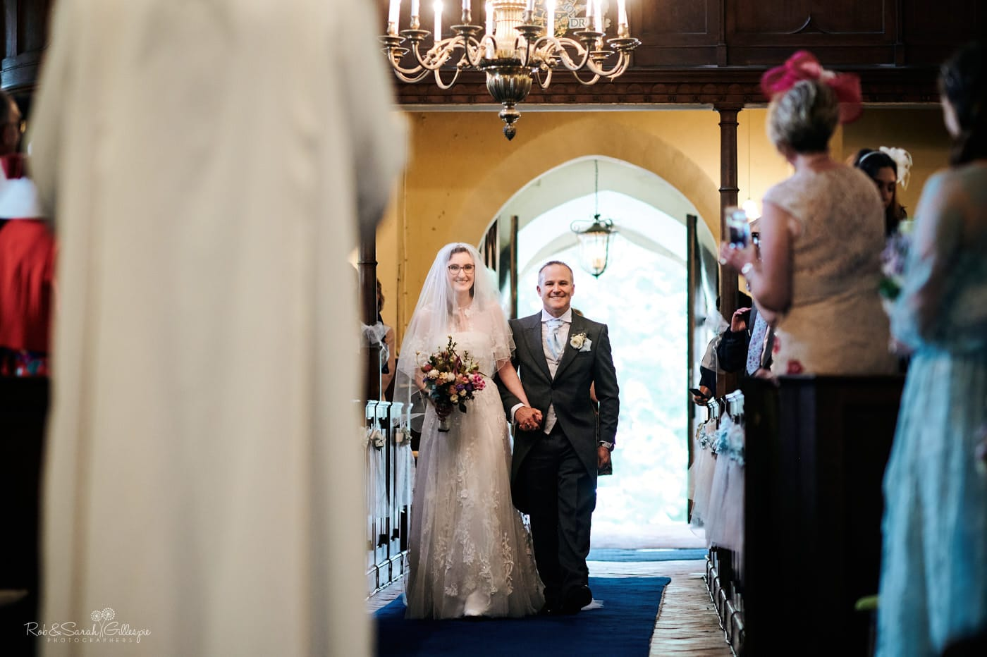 Bride and walk up aisle for wedding ceremony