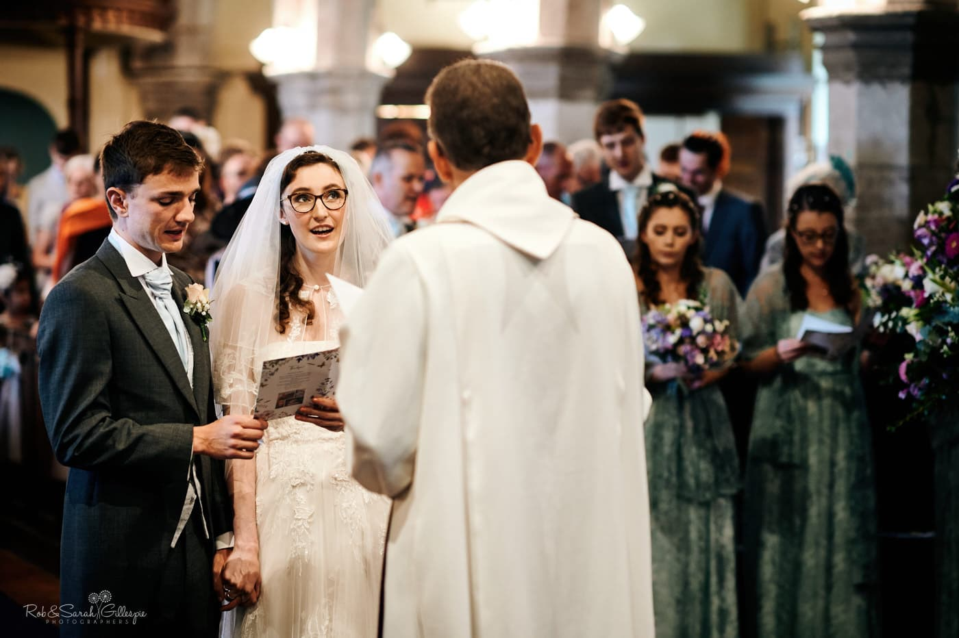 Bride and groom sing hymns during wedding ceremony