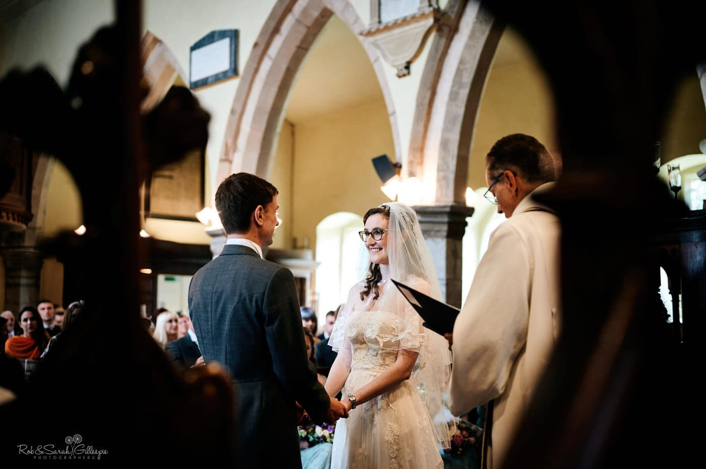 Bride and groom exchange wedding vows at Hanbury Church