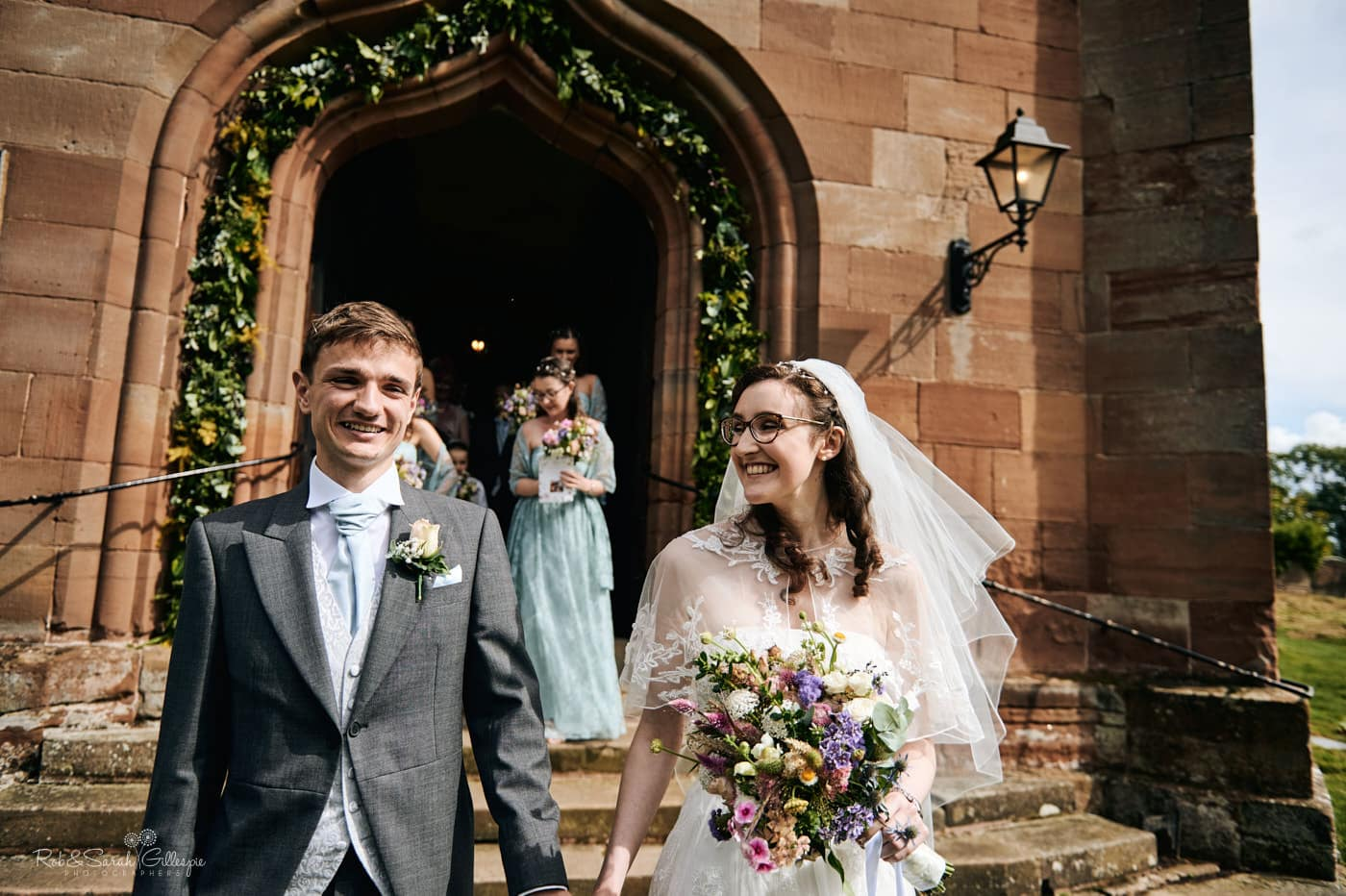 Newly married couple outside Hanbury Church in Worcestershire