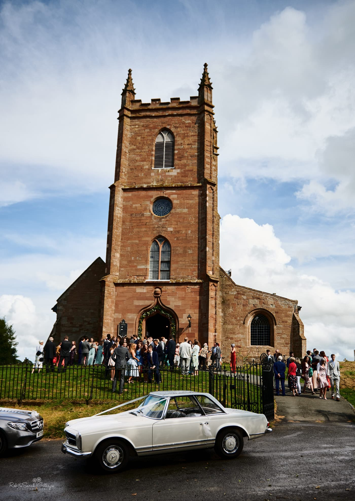 Wedding guests outside Hanbury Church