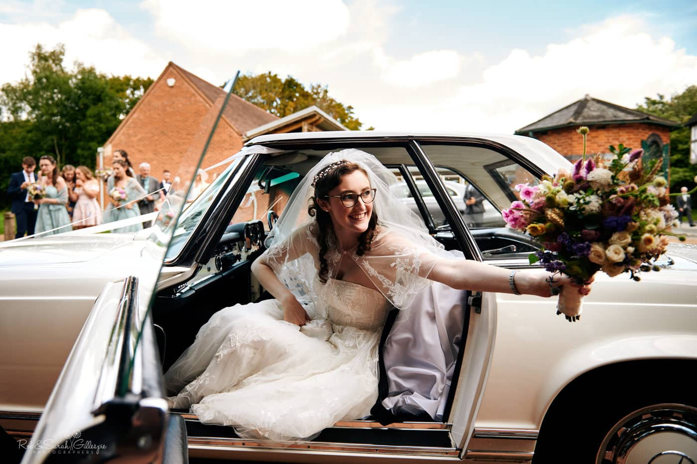 Bride arrives in car at Avoncroft Museum wedding reception
