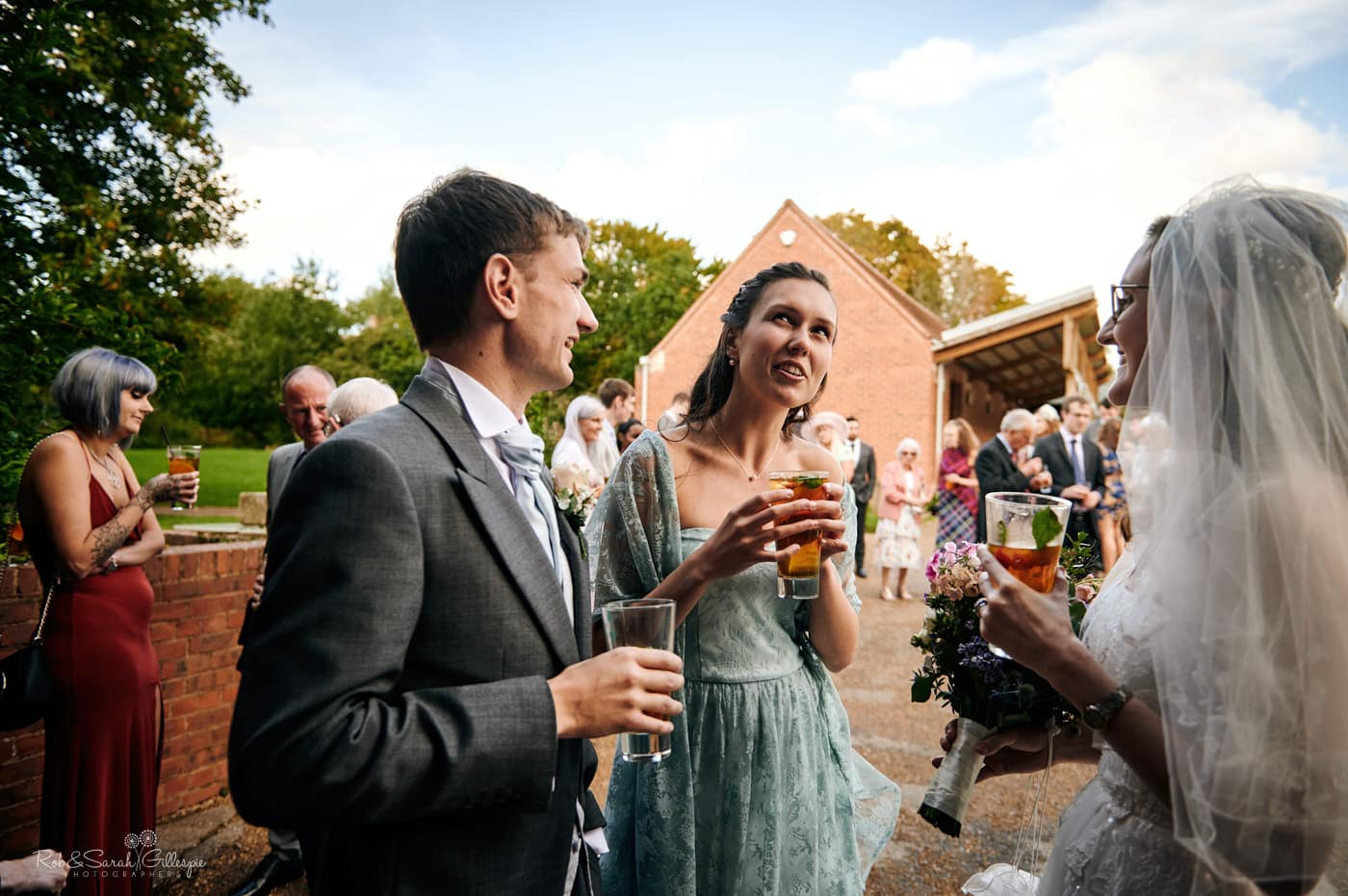 Wedding guests chat and relax at Avoncroft Museum