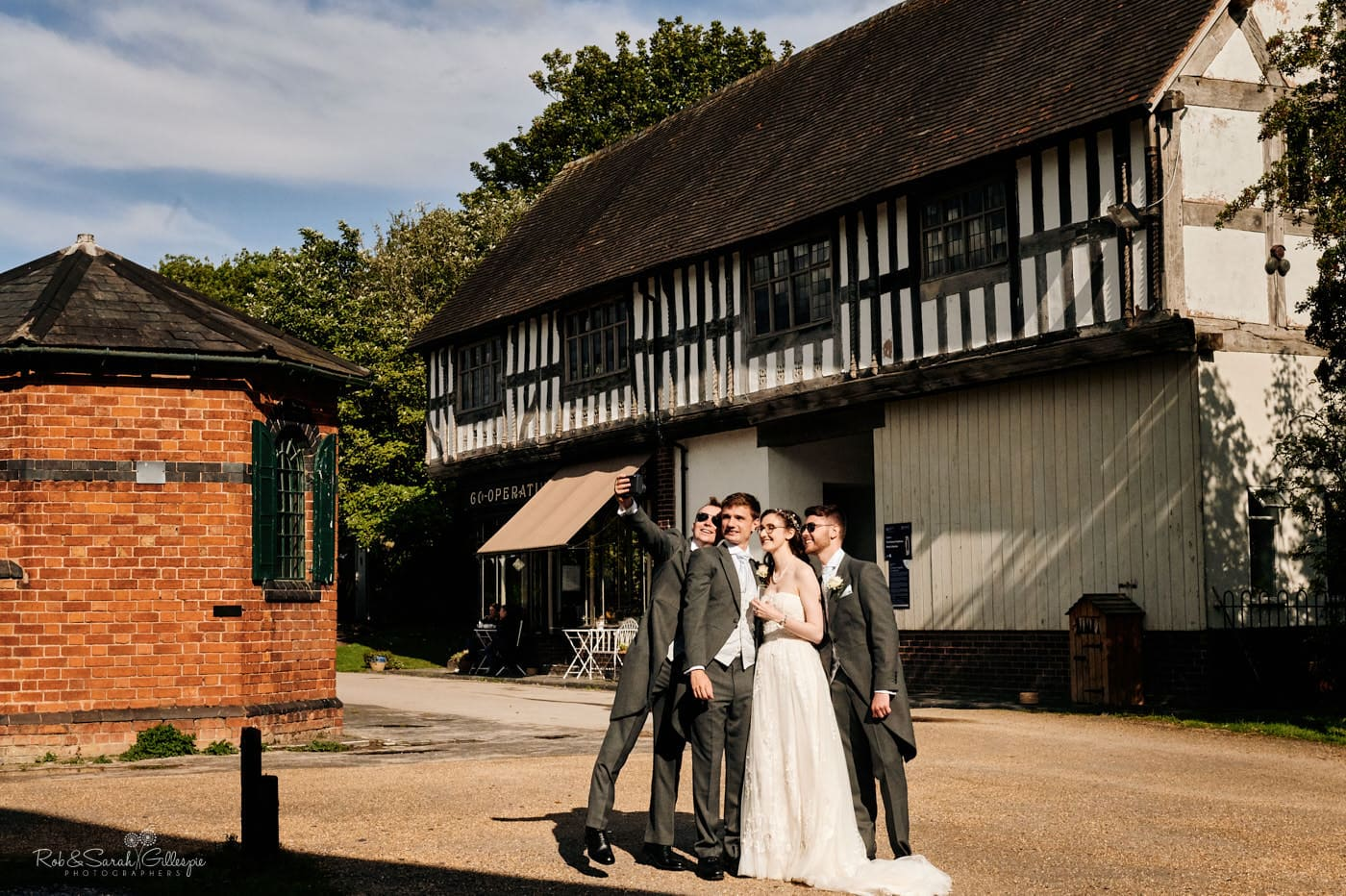 Bride, groom and friends take selfi at Avoncroft Museum