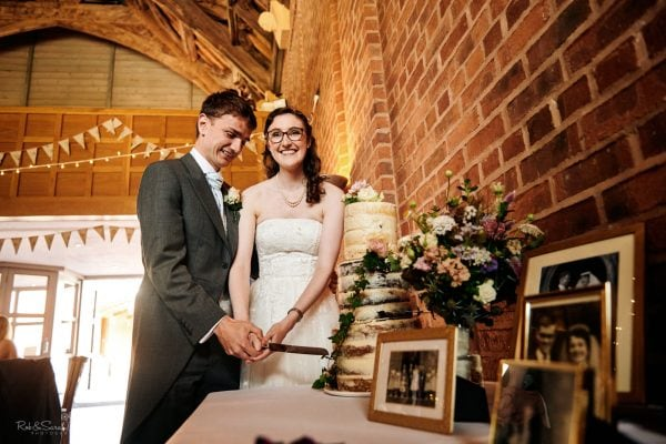 Bride and groom cut wedding cake at Avoncroft Museum
