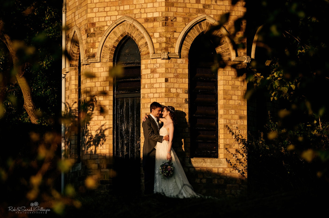 Bride and groom together outside building at Avoncroft Museum. Photographed by Avoncroft Museum Wedding Photographers Rob & Sarah Gillespie