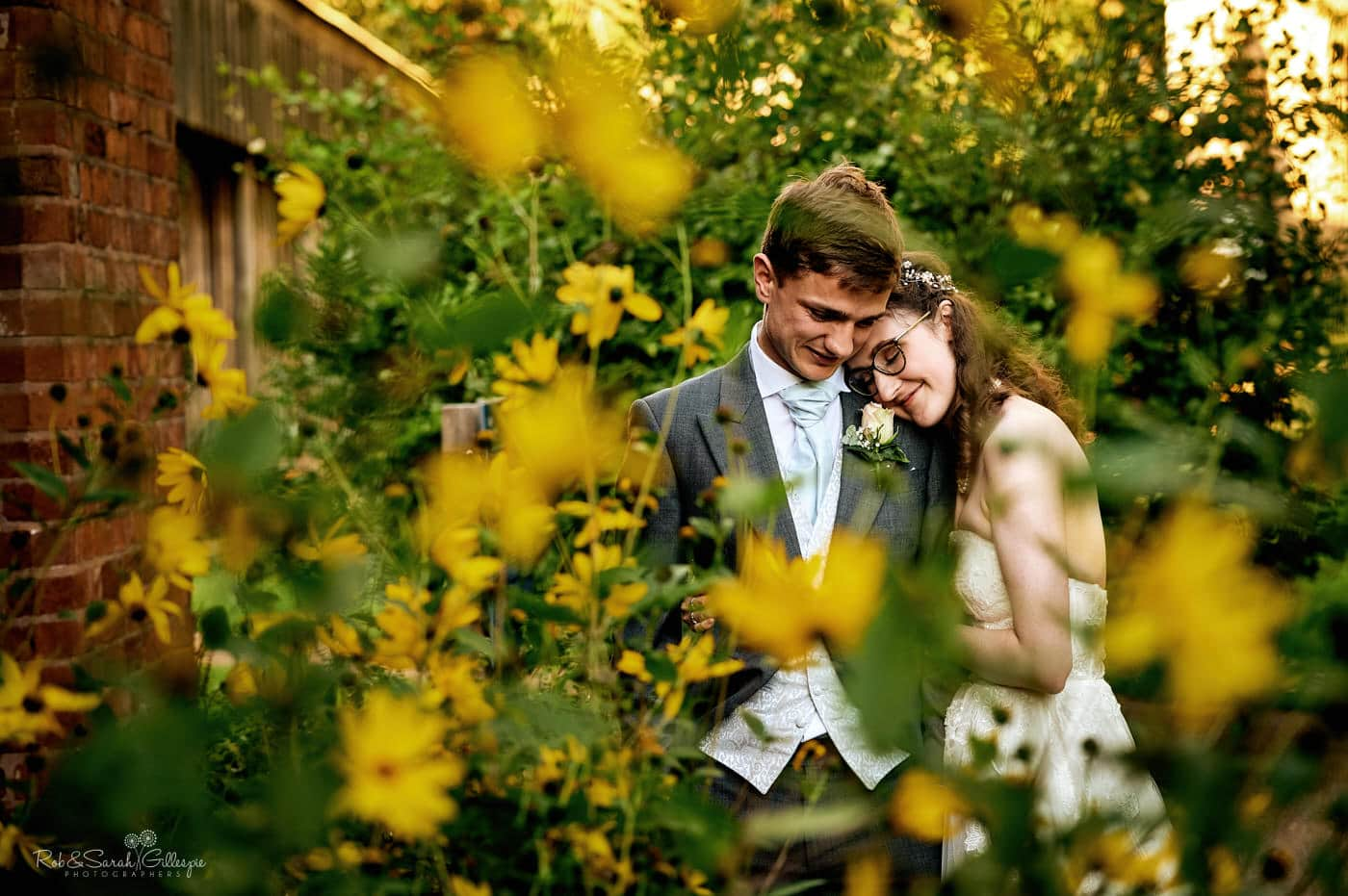 Bride and groom happy together with yellow flowers