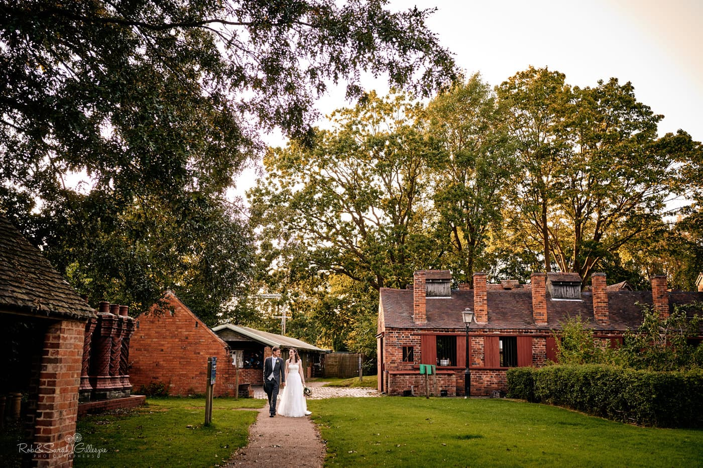 Bride and groom waking through Avoncroft Museum. Photographed by Avoncroft Museum wedding photographers Rob & Sarah Gillespie