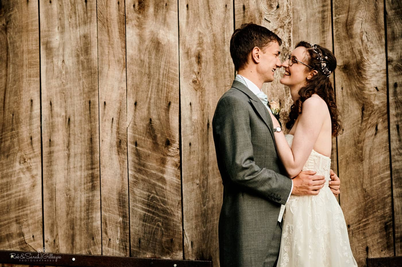 Relaxed bride and groom with old barn doors