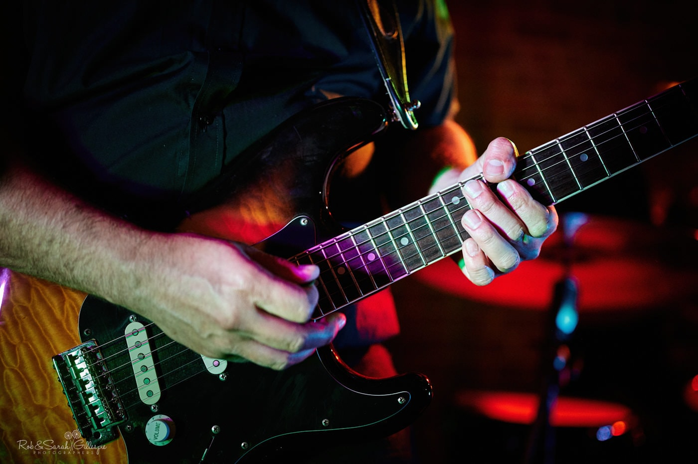 Close up of guitar as wedding band play