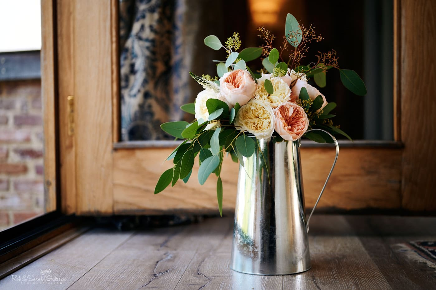 Bridal bouquet sitting in crome decanter