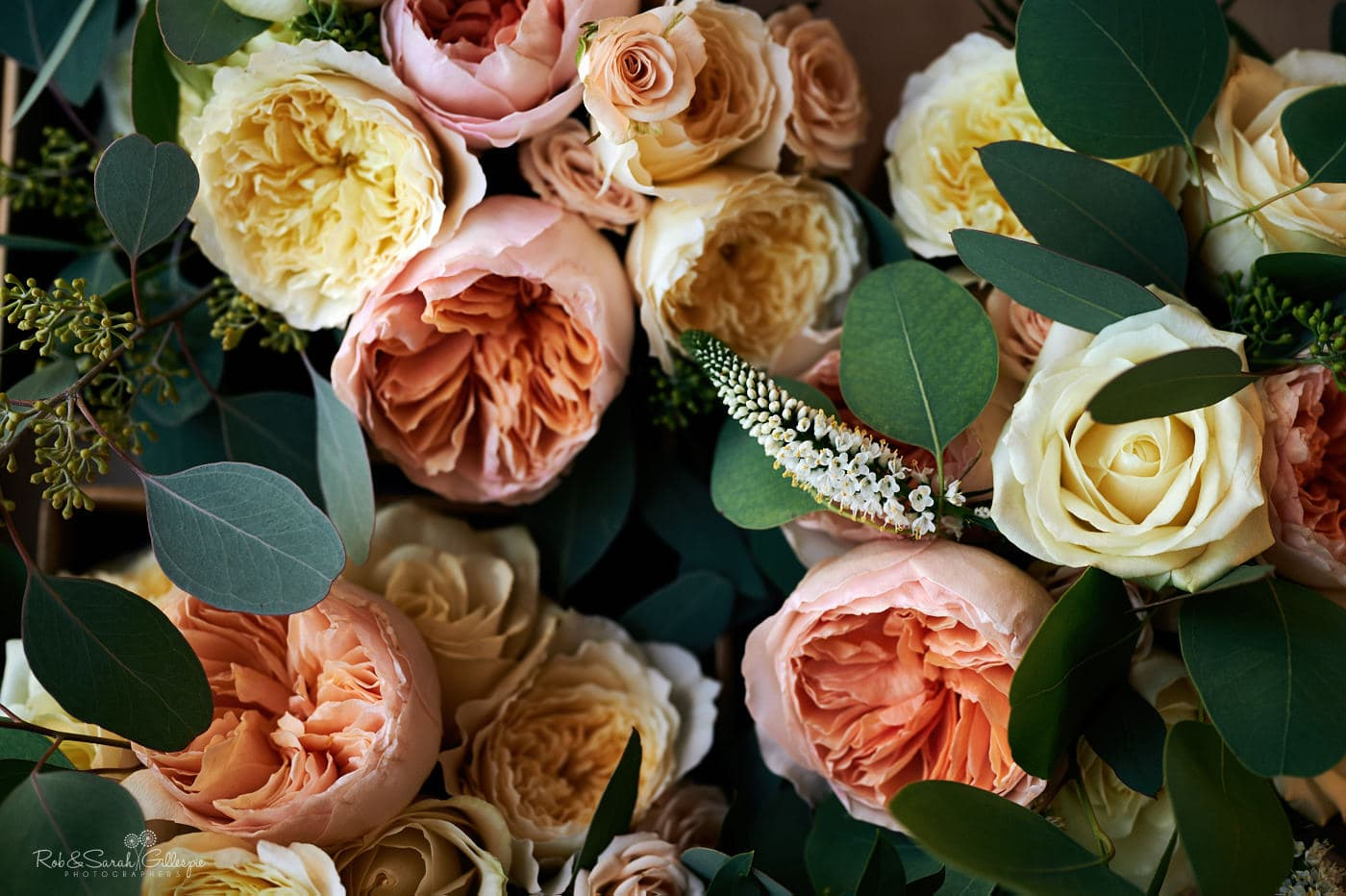 Wedding flowers in shades of yellow, peach and pink