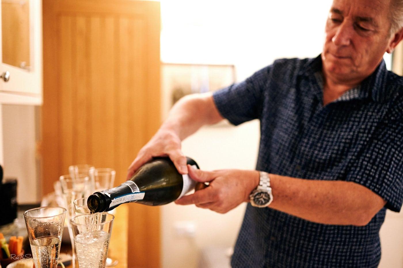Bride's dad pouring drink