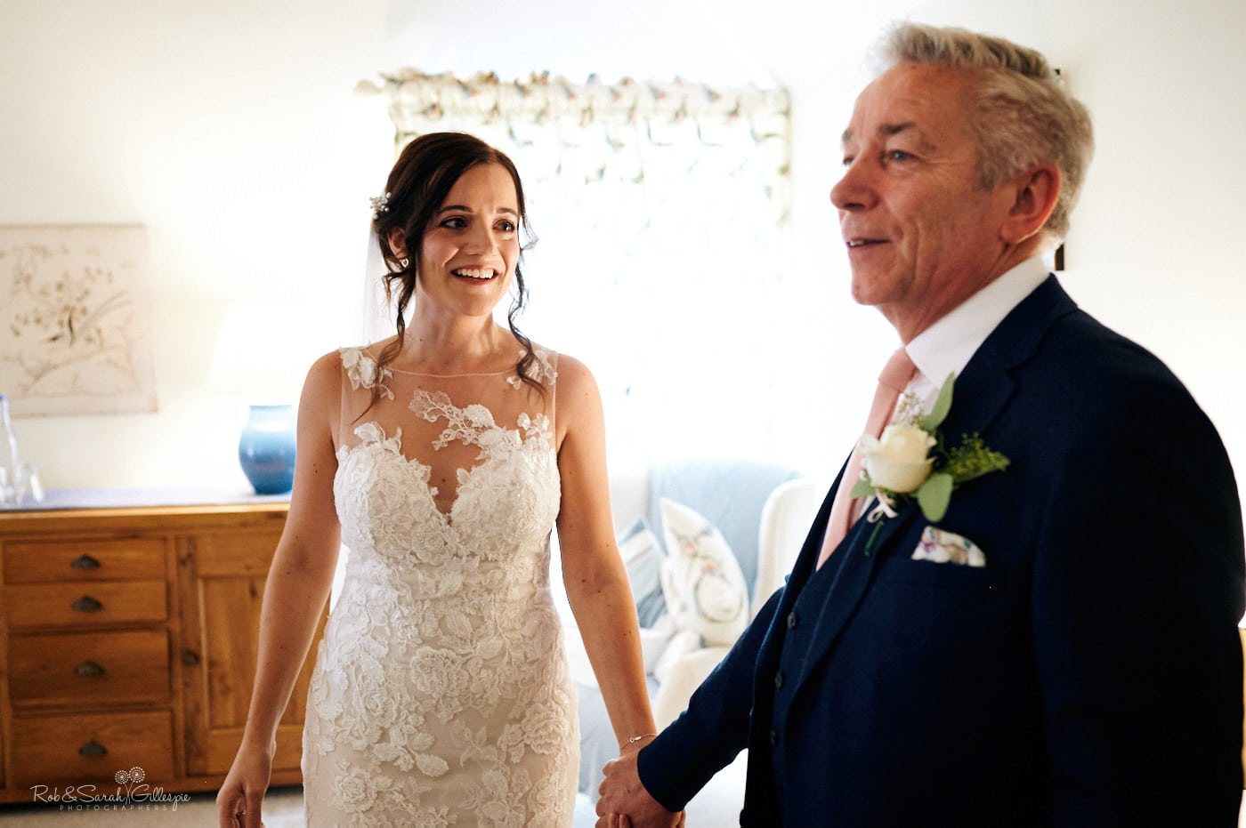 Bride and father share a moment before wedding