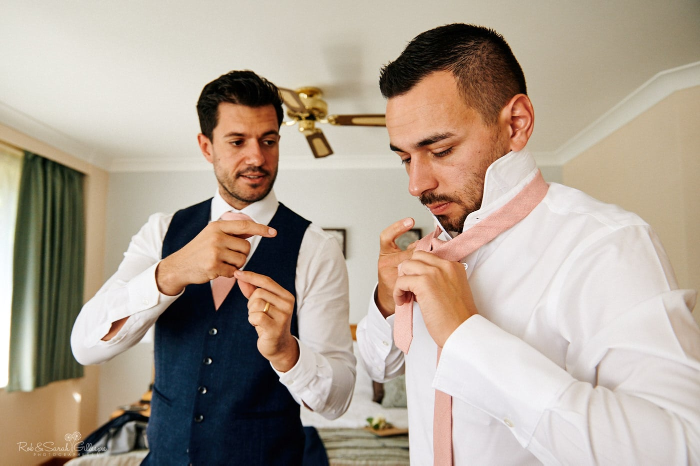 Groom and groomsmen prepare for wedding