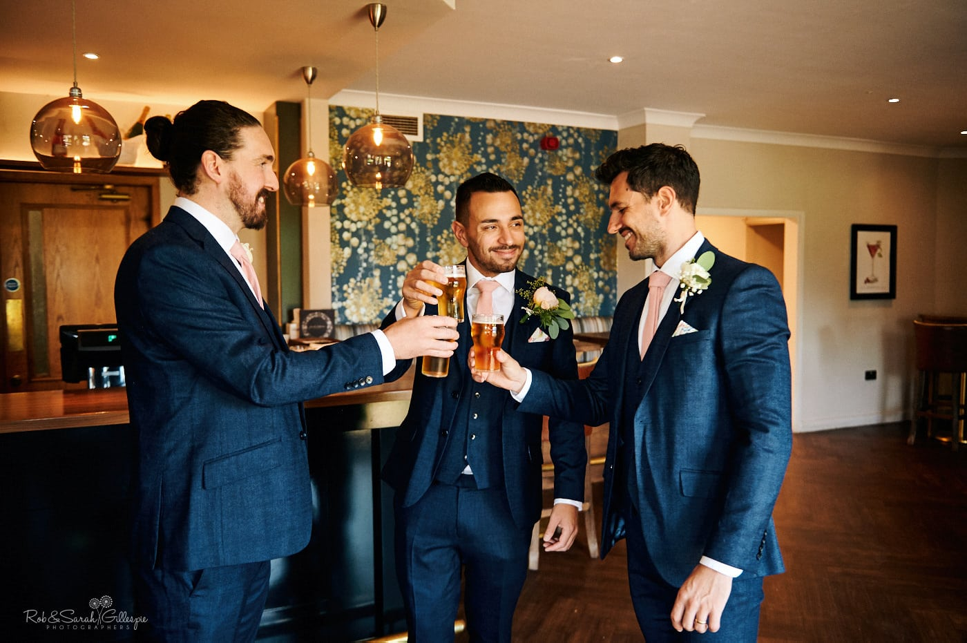 Groomsmen have a drink in bar before wedding