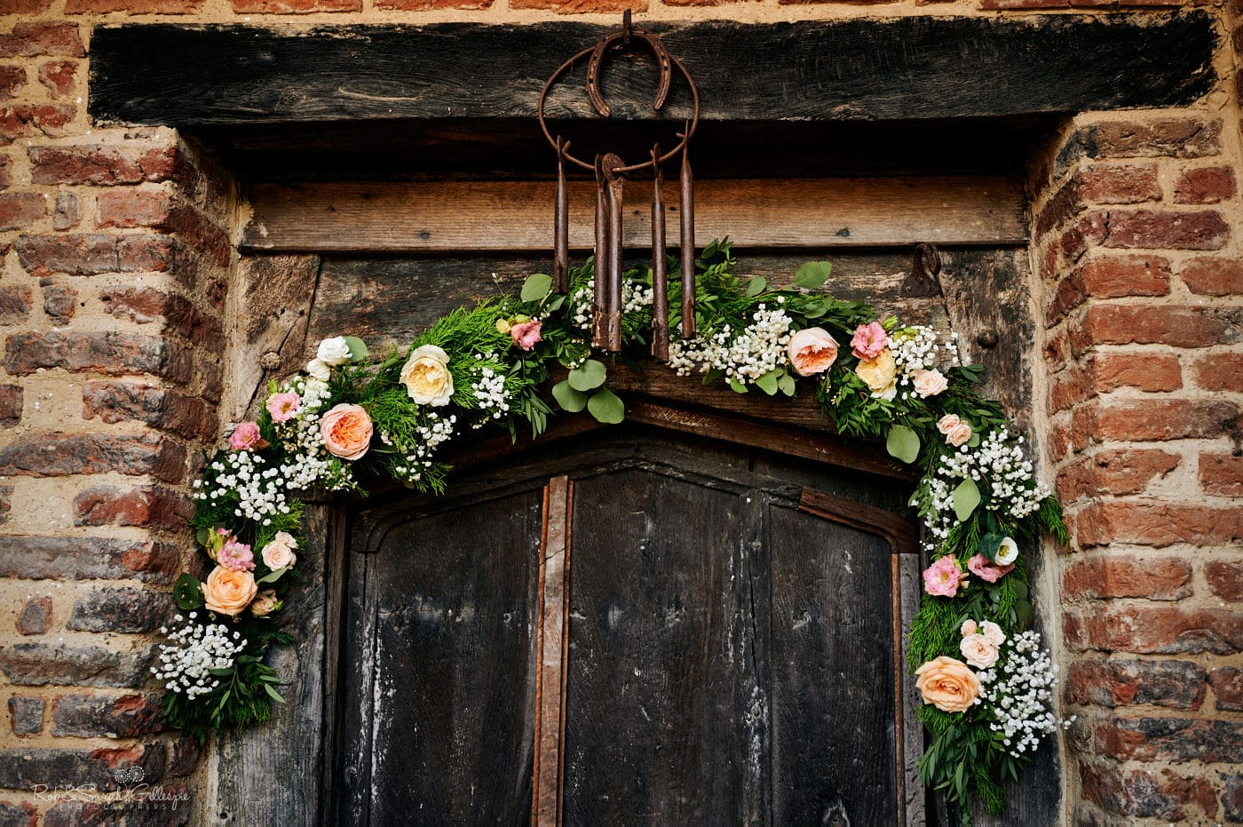 Flowers decorte old doorway at Gorcott Hall