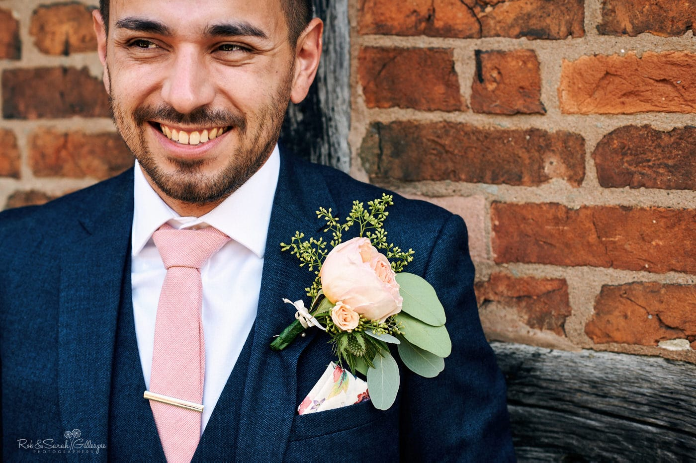Portrait of groom at Gorcott Hall wedding
