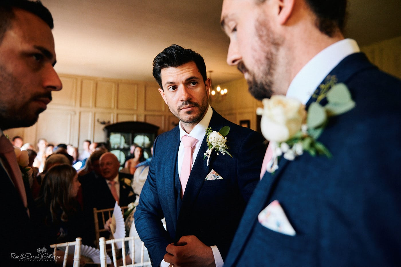 Best man talks to groom before wedding ceremony