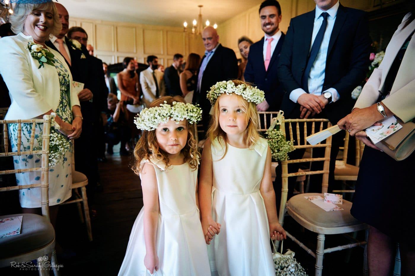 Flowegirls make entrnace at Gorcott Hall wedding ceremony