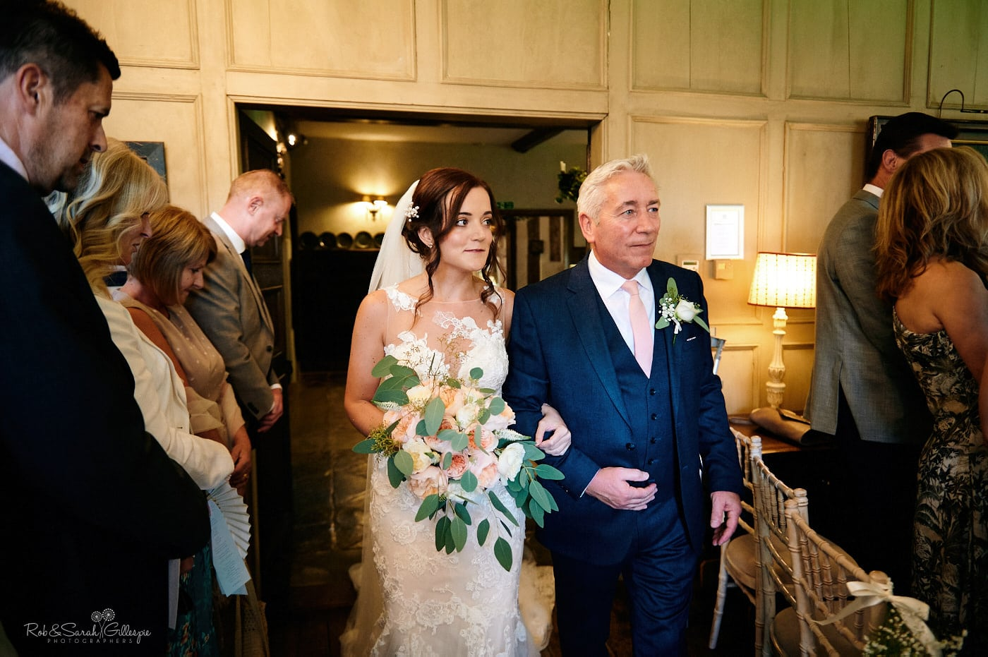 Bride and father enter wedding ceremony at Gorcott Hall