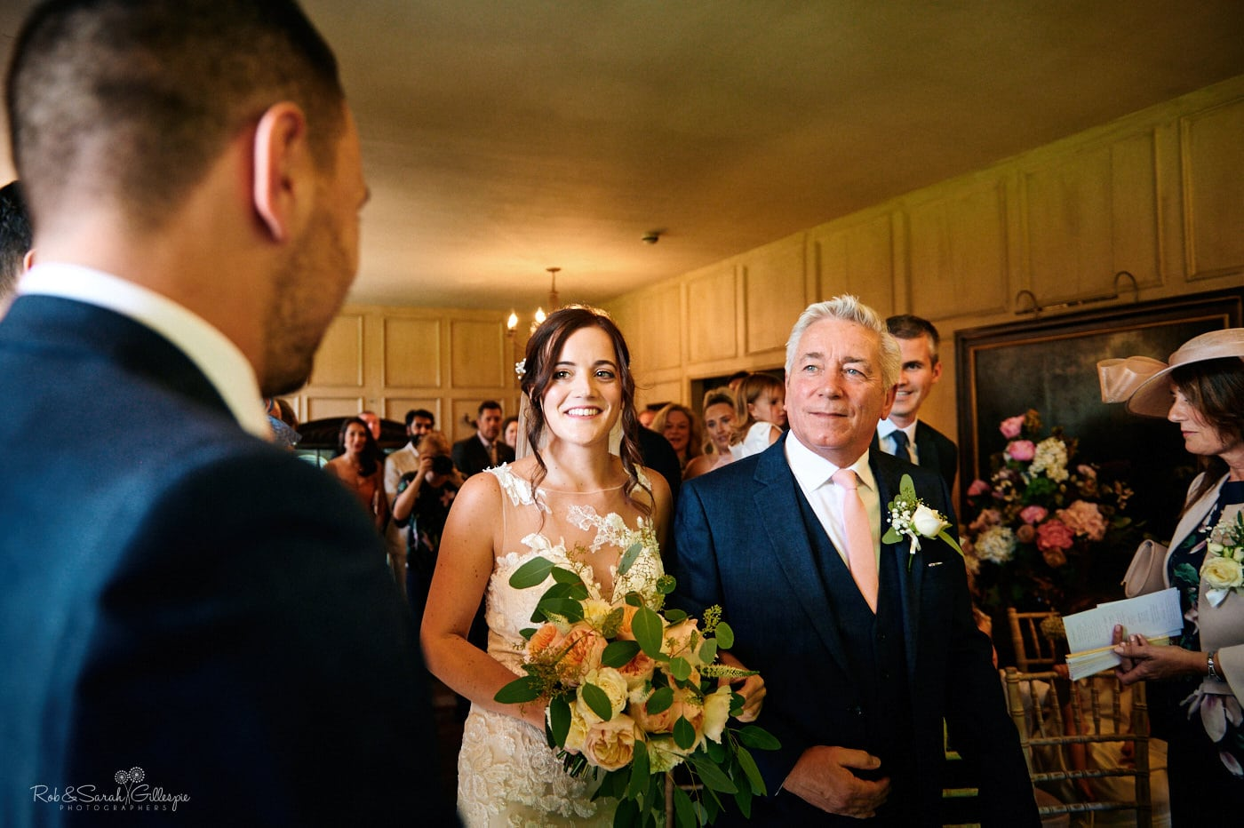 Bride and father walk up aisle at Gorcott Hall wedding