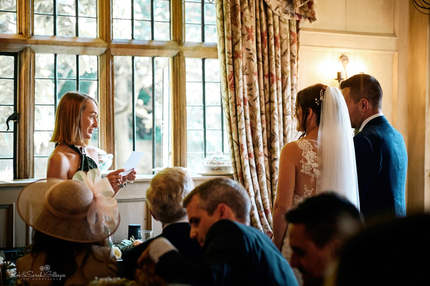 Wedding guest gives reading during wedding ceremony