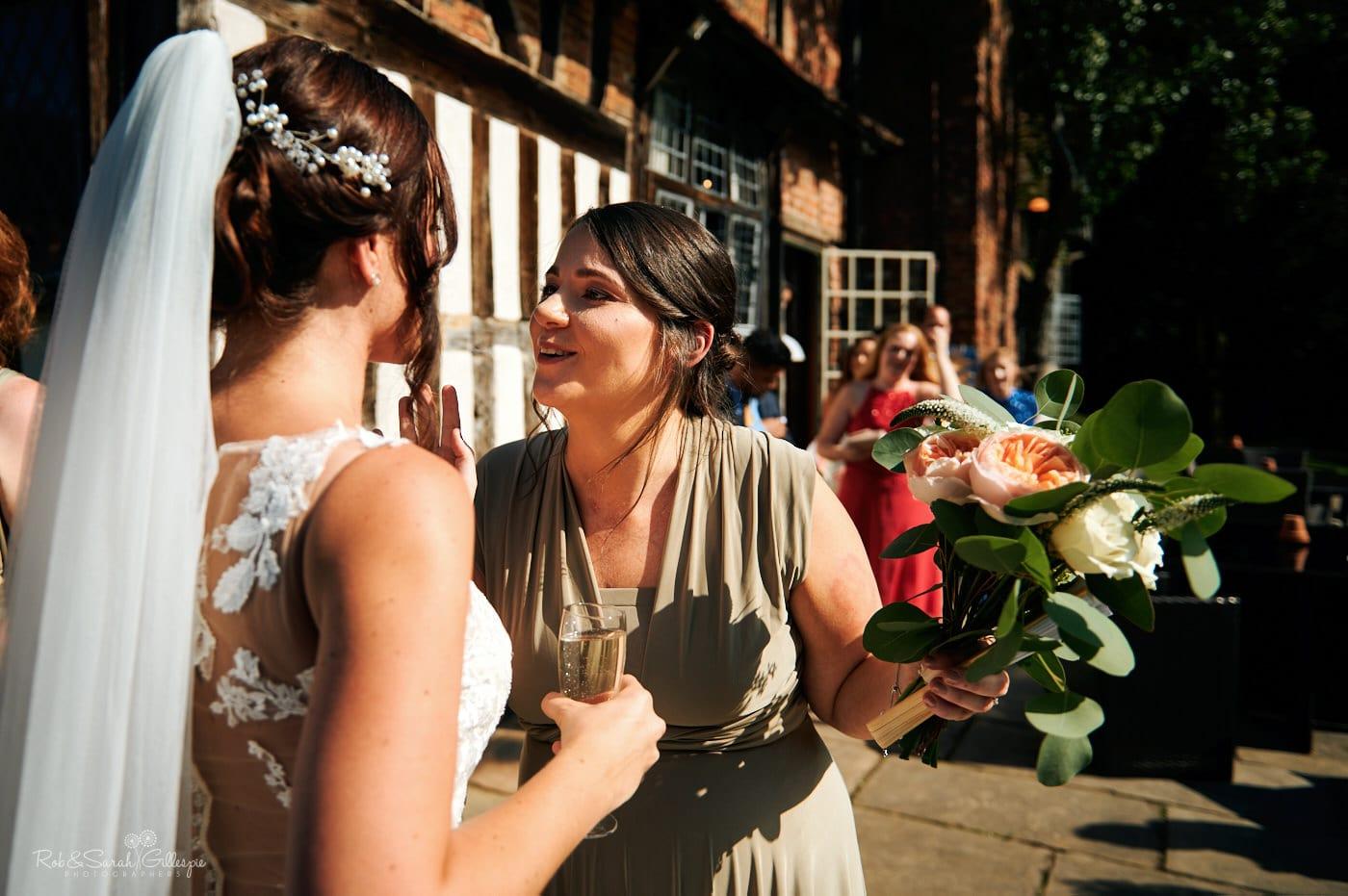 Wedding guests congratulate bride after ceremony