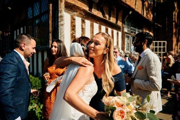 Wedding guests congratulate bride after wedding ceremony