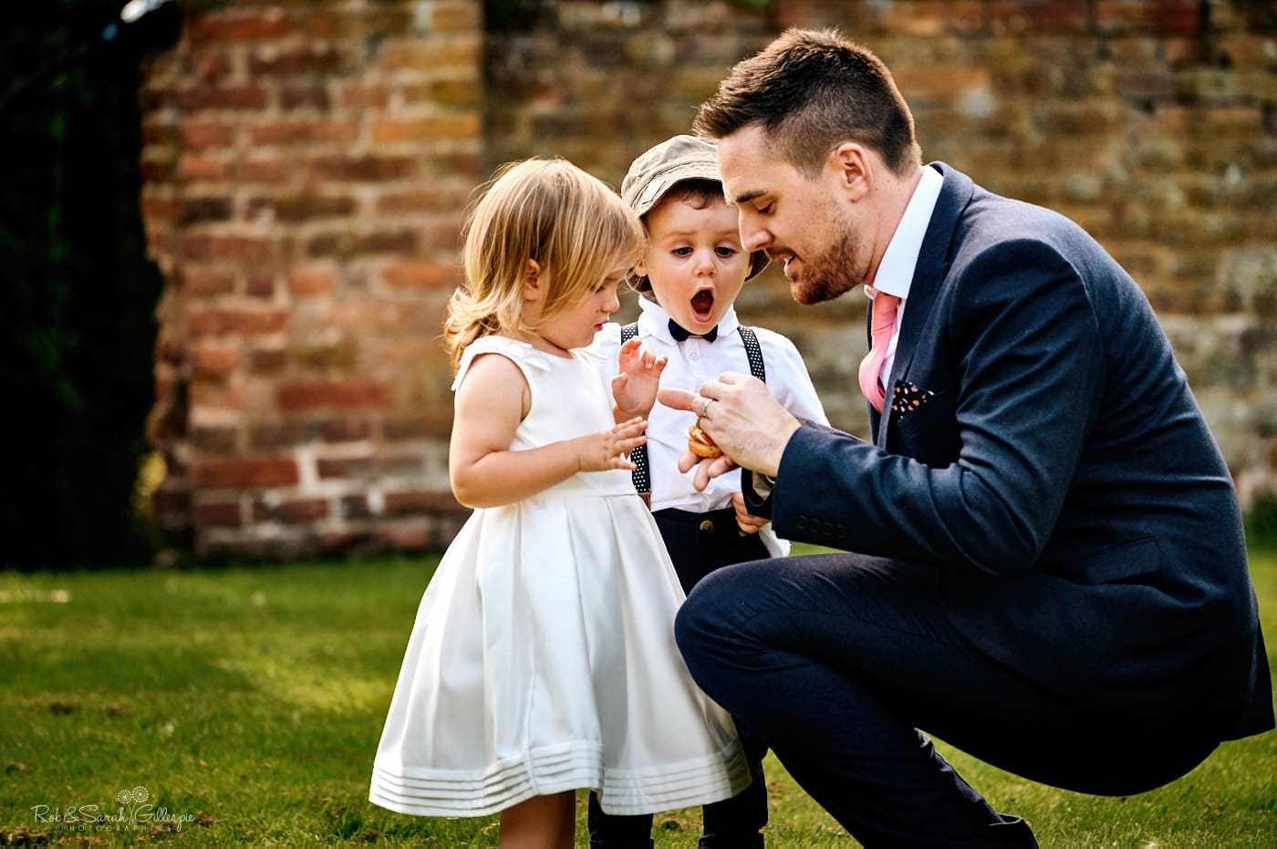 Wedding guest plays with kids during reception