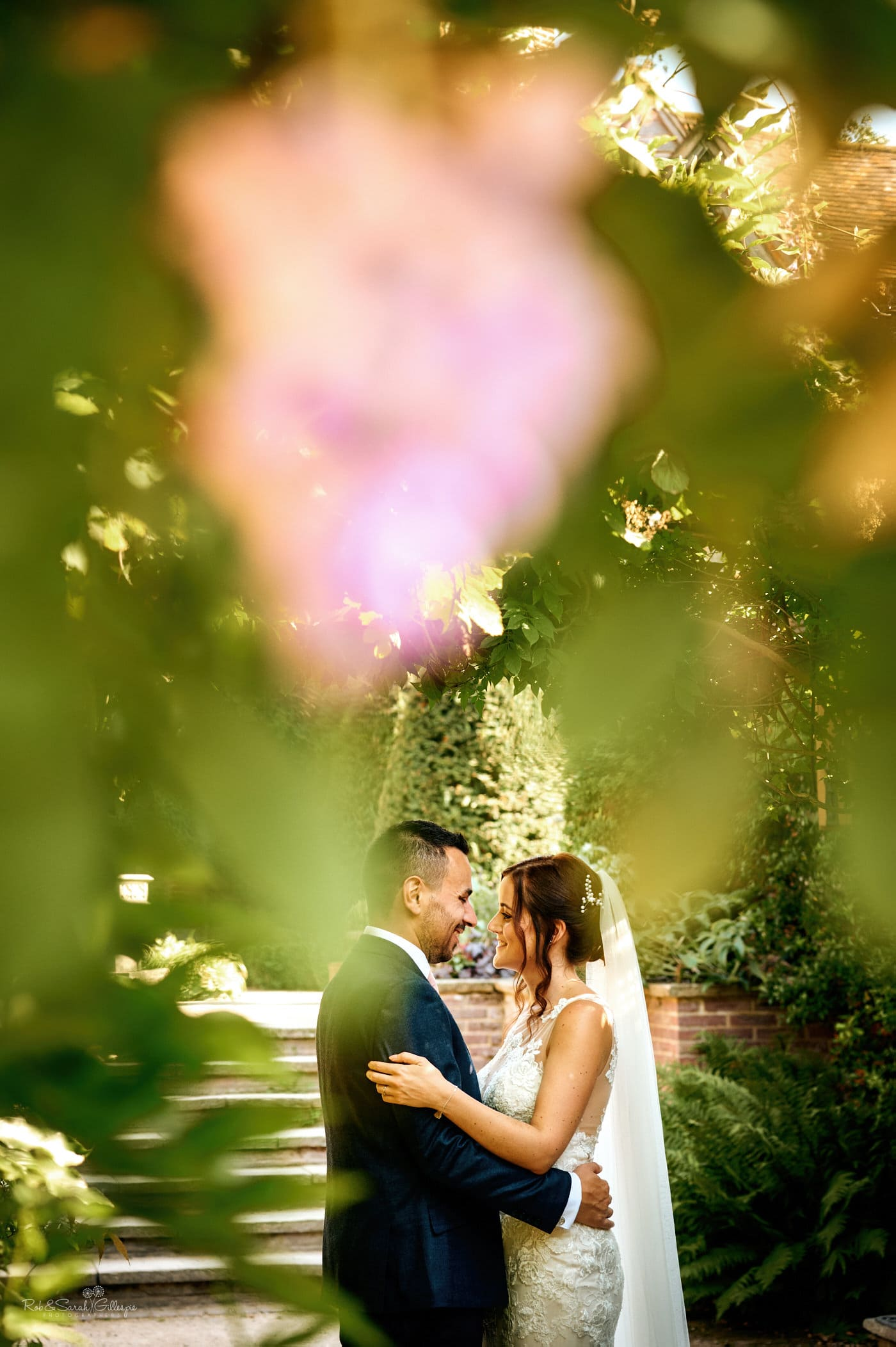 Bride and groom together at Gorcott Hall surrounded by gardens
