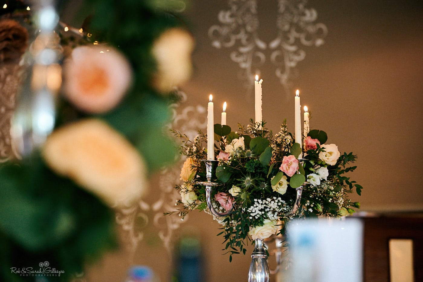 Close up on chandaliers and flowers for wedding meal