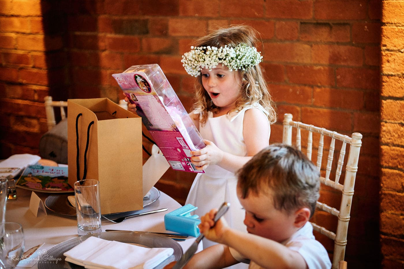 Flowergirl receives gift before wedding meal